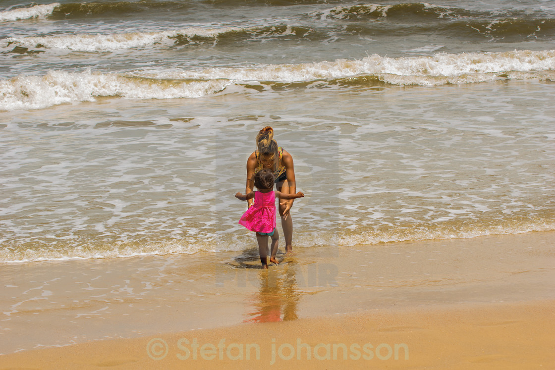 """""""Mother and daughter on beach"""" stock image"""