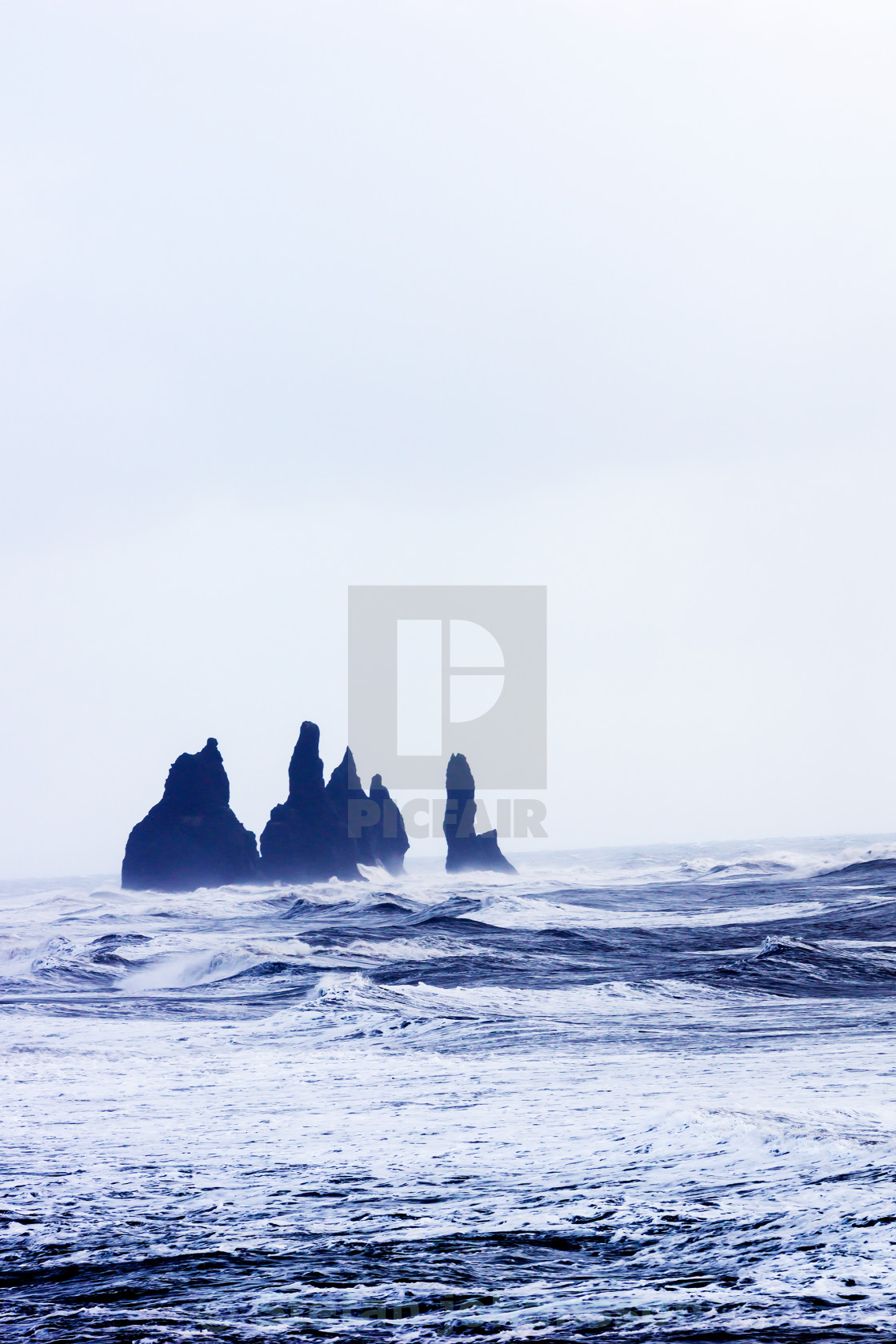 """Rock formation in ocean"" stock image"