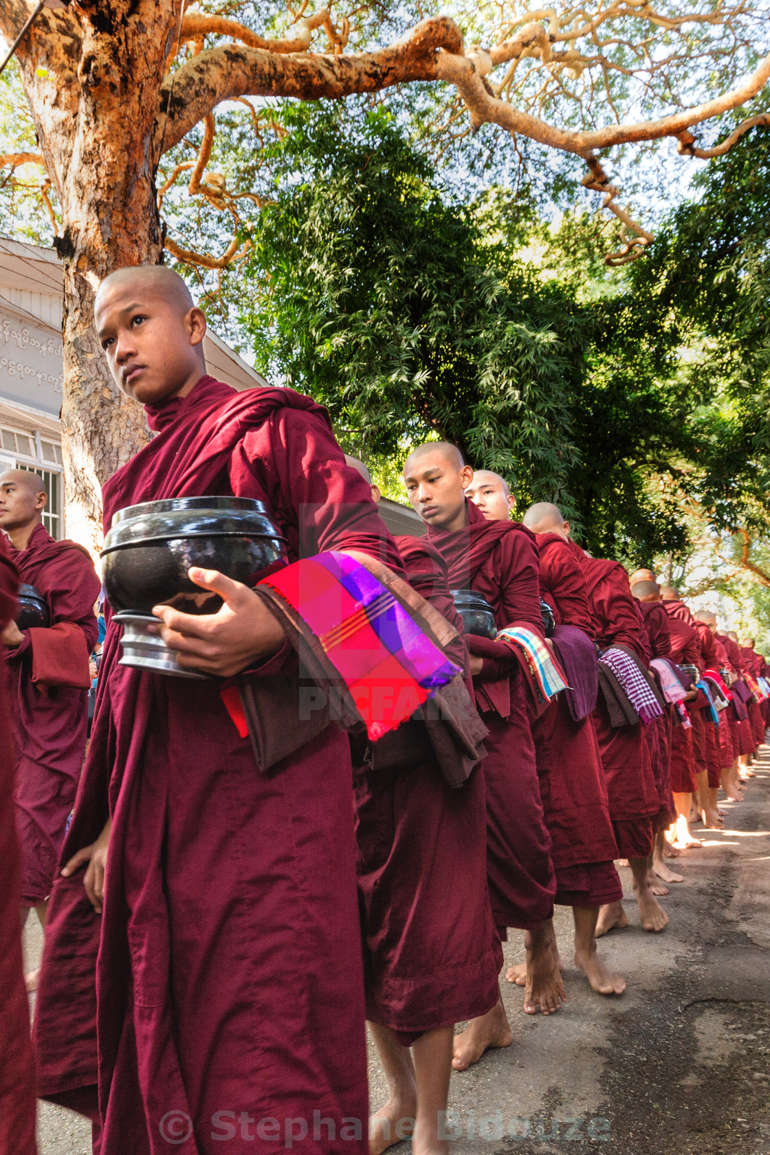 """Burmese monks queueing for meal"" stock image"