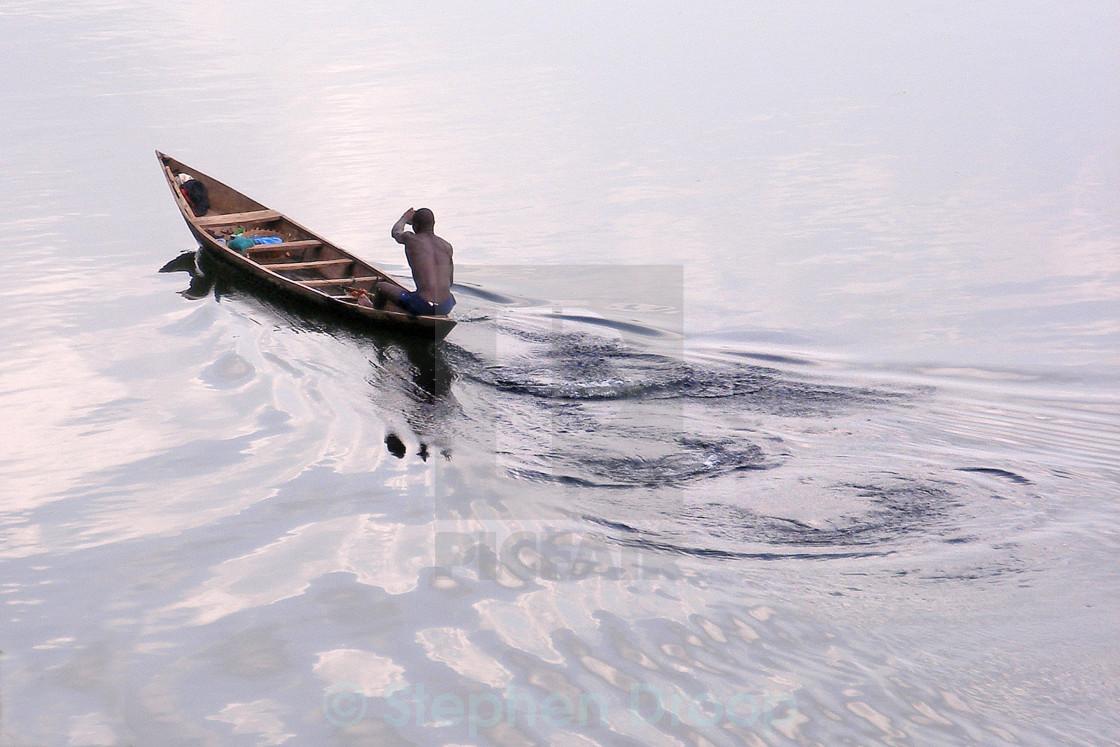 """""""Paddling fisherman"""" stock image"""