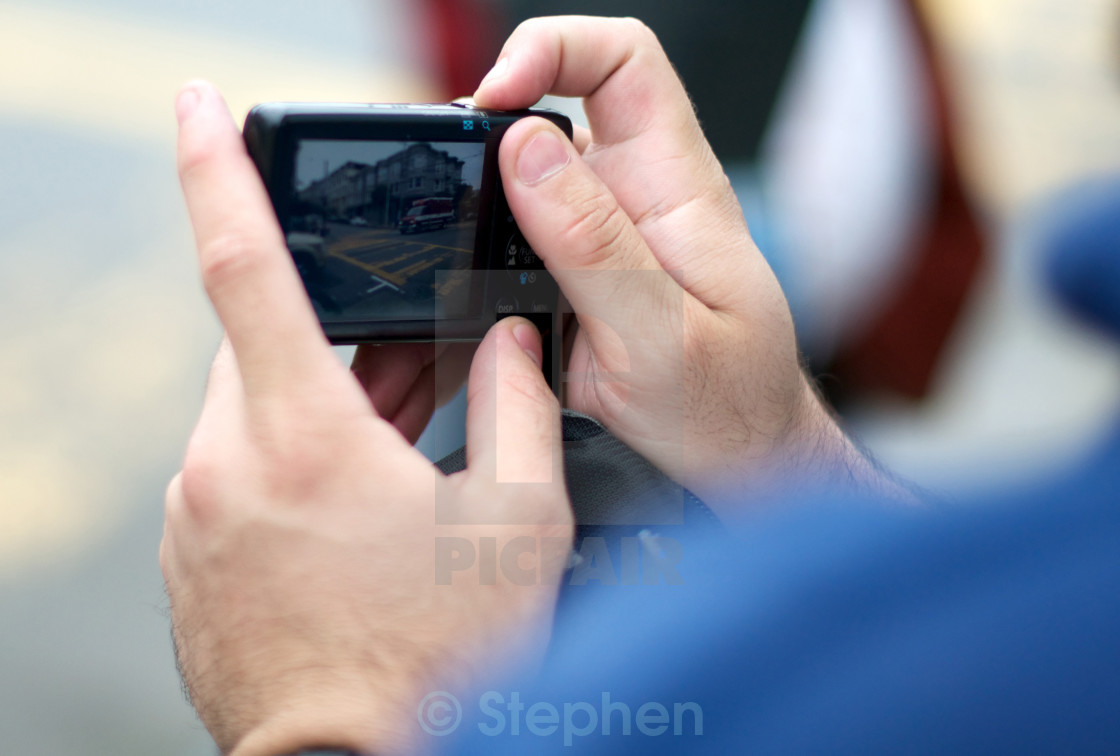"""""""Close up of a man taking a picture of an ambulance"""" stock image"""