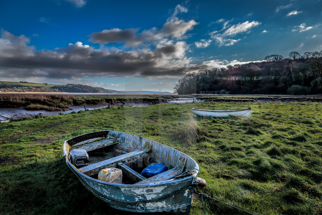 """small boats in laugharne"" stock image"