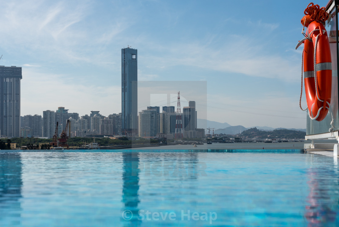 Skyline of the city of Xiamen from infinity edge swimming ...
