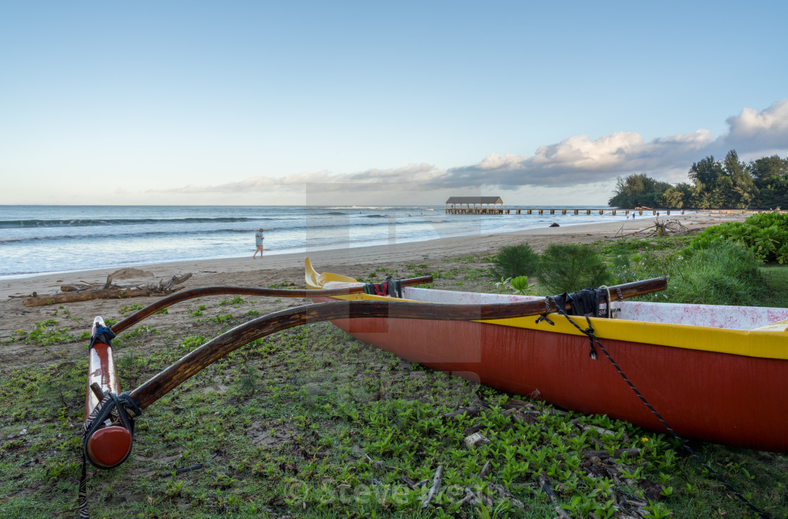 Traditional Hawaiian canoe by Hanalei pier Kauai - License