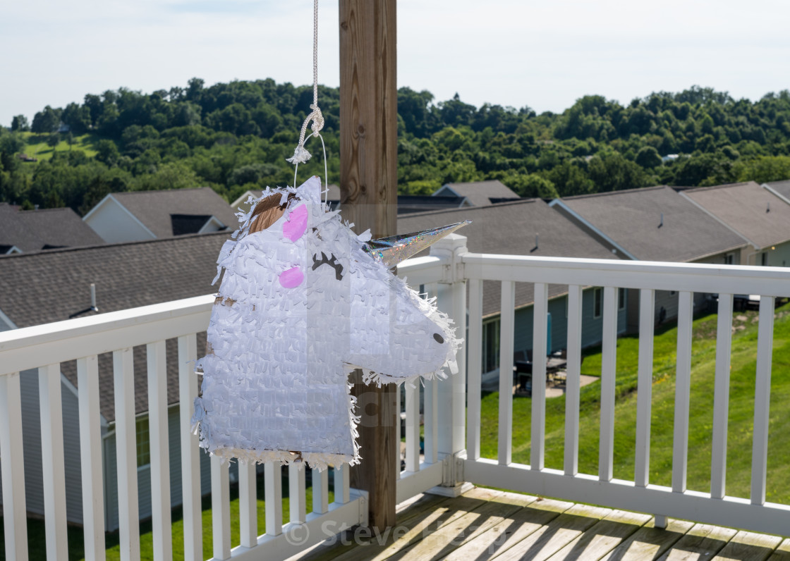 White unicorn shaped pinata after being beaten at childs