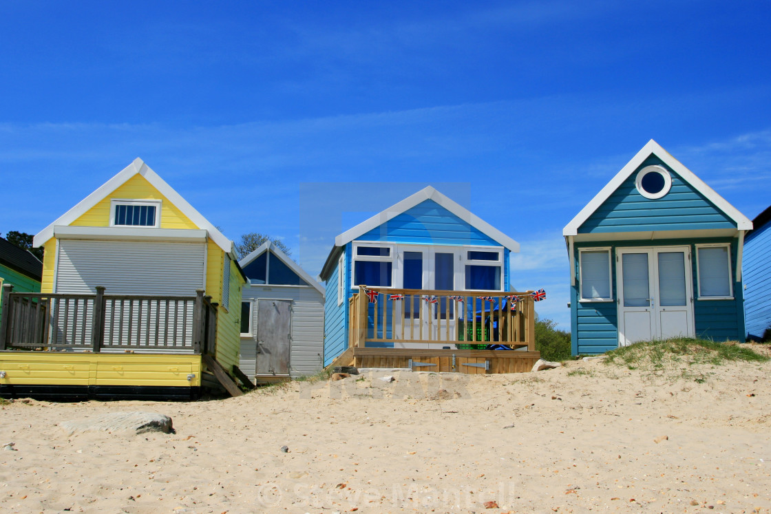 """Trio of colourful beach huts"" stock image"