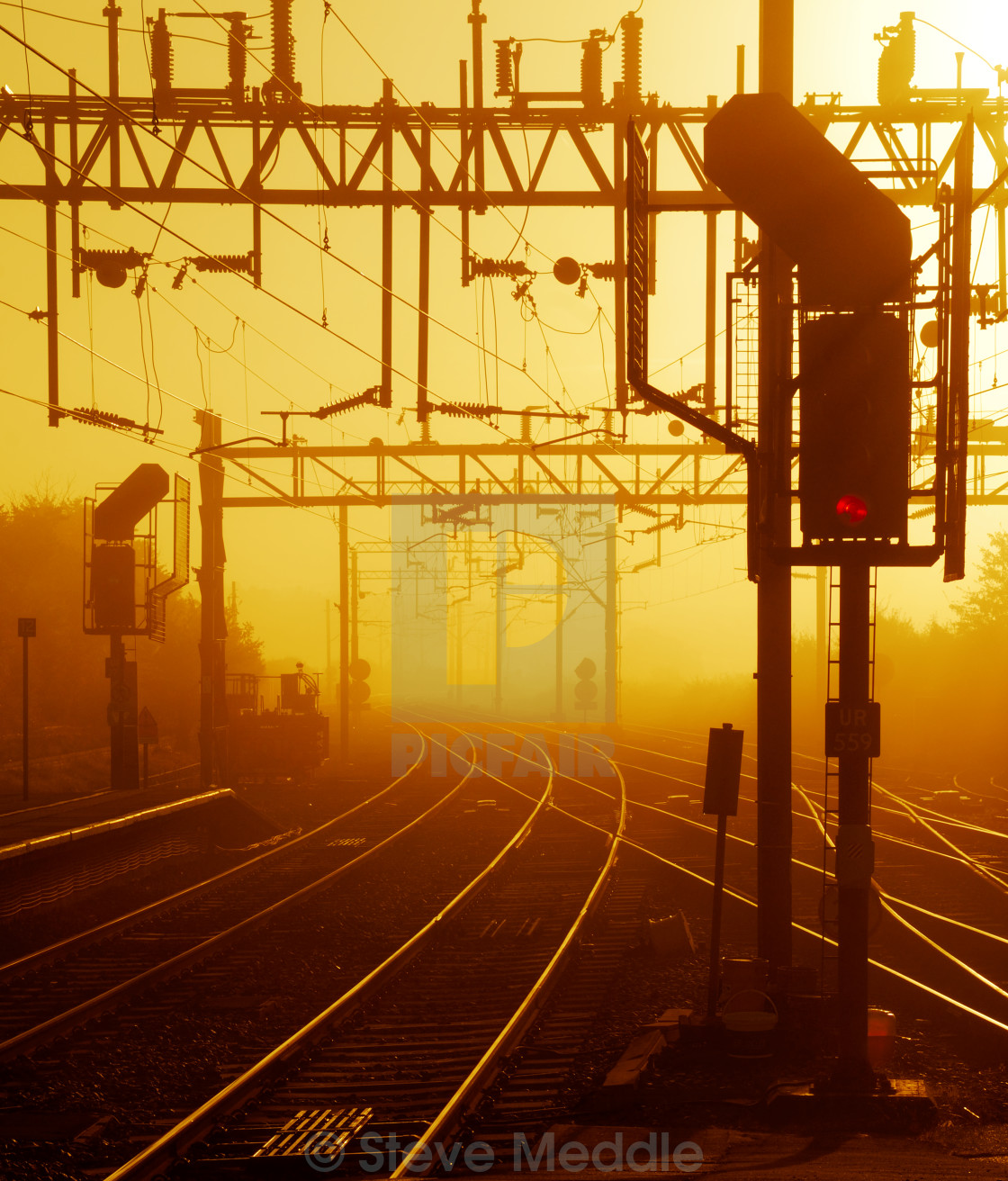 """Railway Train Tracks at Sunrise"" stock image"
