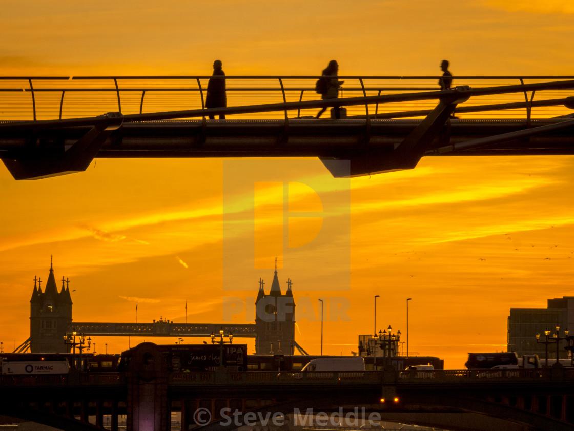 """Commuters on Millennium Bridge at Sunrise, London"" stock image"