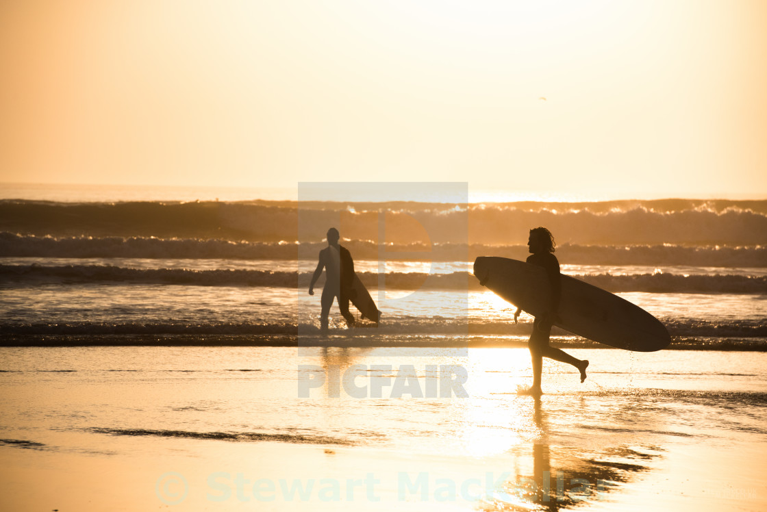 """A long day surfing"" stock image"