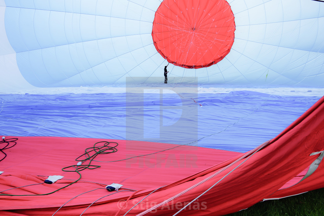"""Man in the interior of a hot air balloon"" stock image"