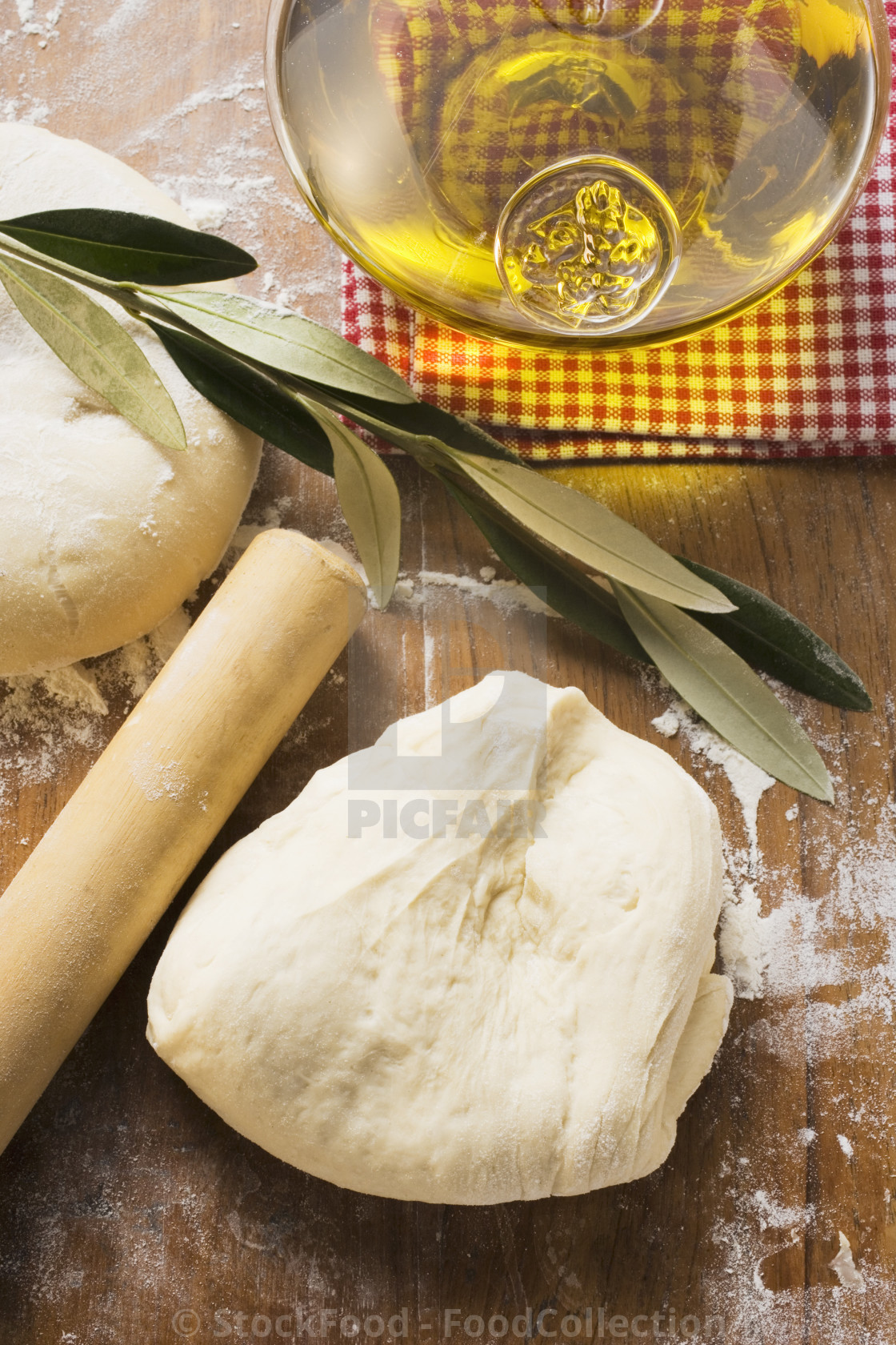 """Dough, rolling pin, ball of dough, olive oil & olive branch"" stock image"