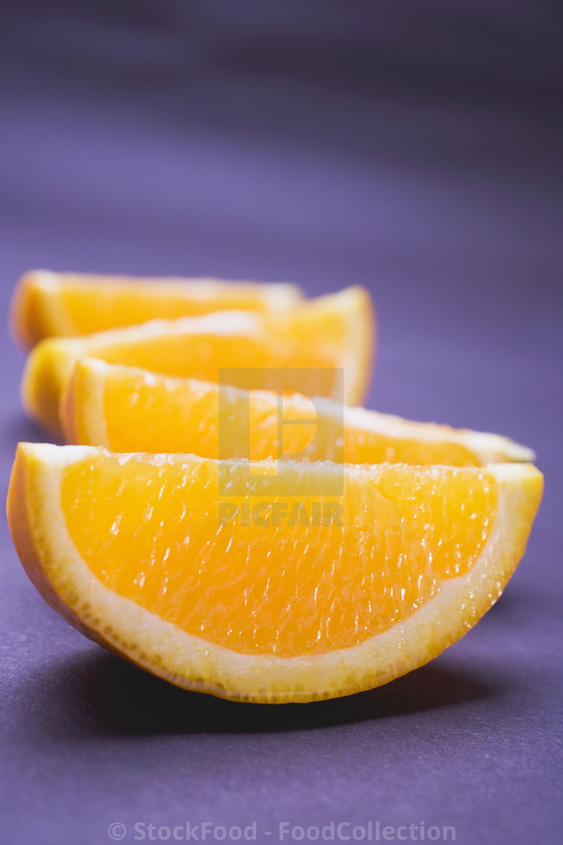 """Several orange wedges"" stock image"