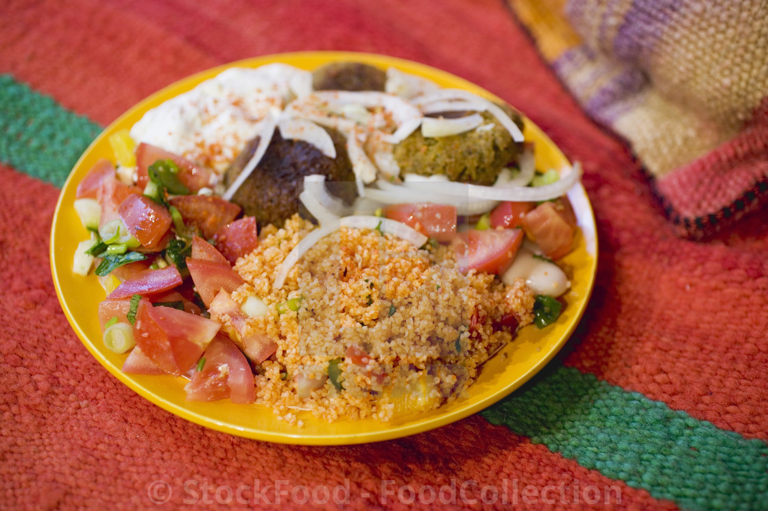 """""""Falafel with couscous, tomato salad & yoghurt (N. Africa)"""" stock image"""