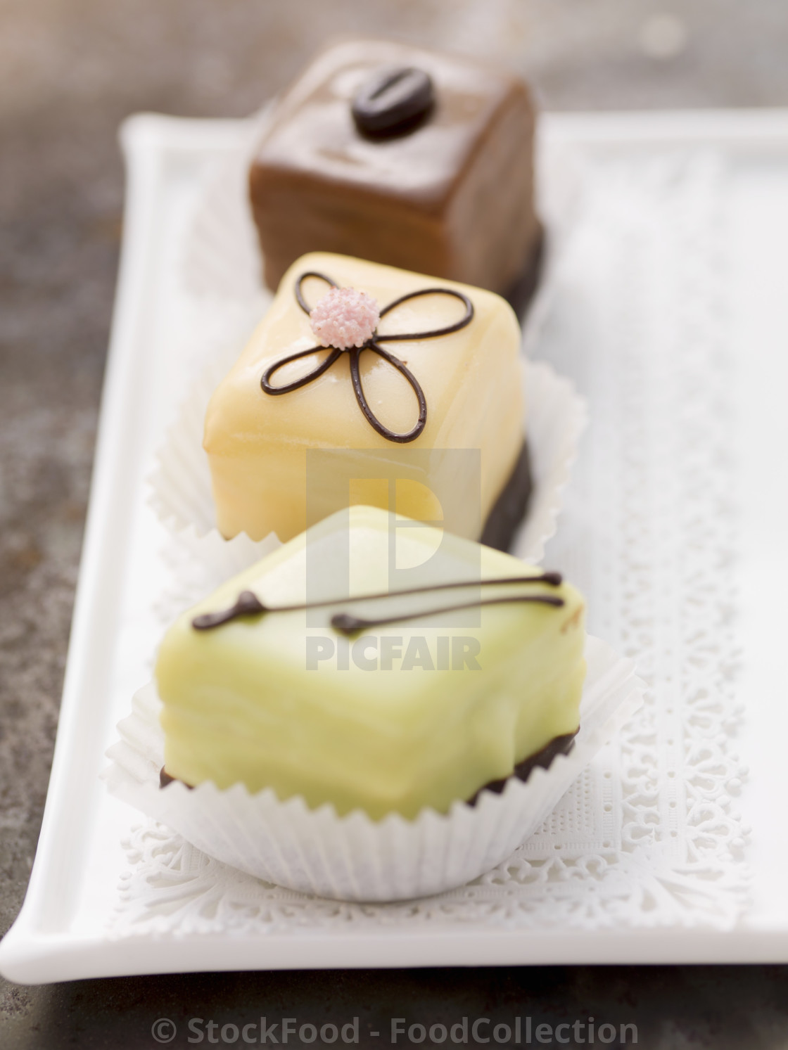 """Three different petits fours"" stock image"