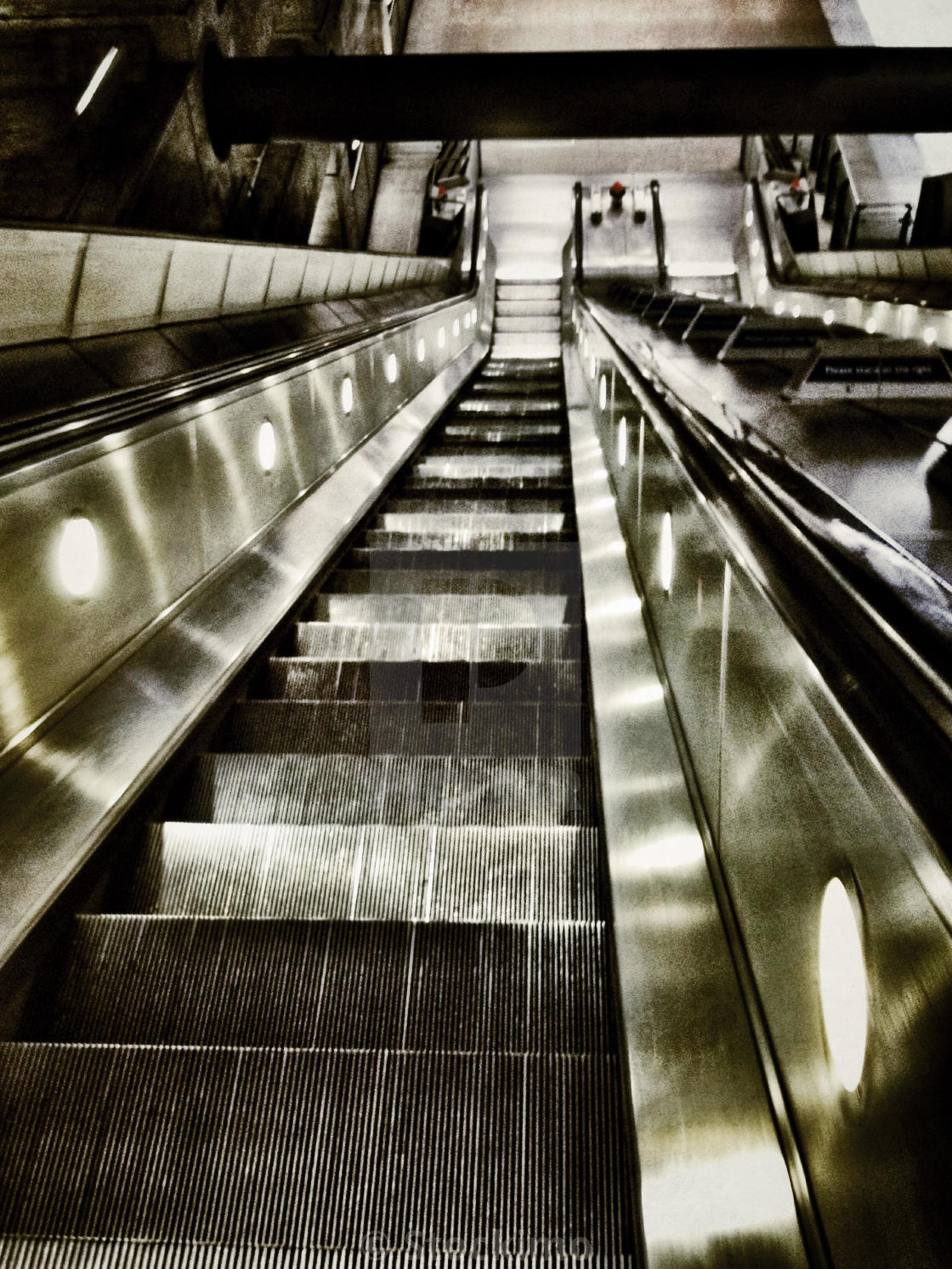 """Looking down a deserted escalator"" stock image"