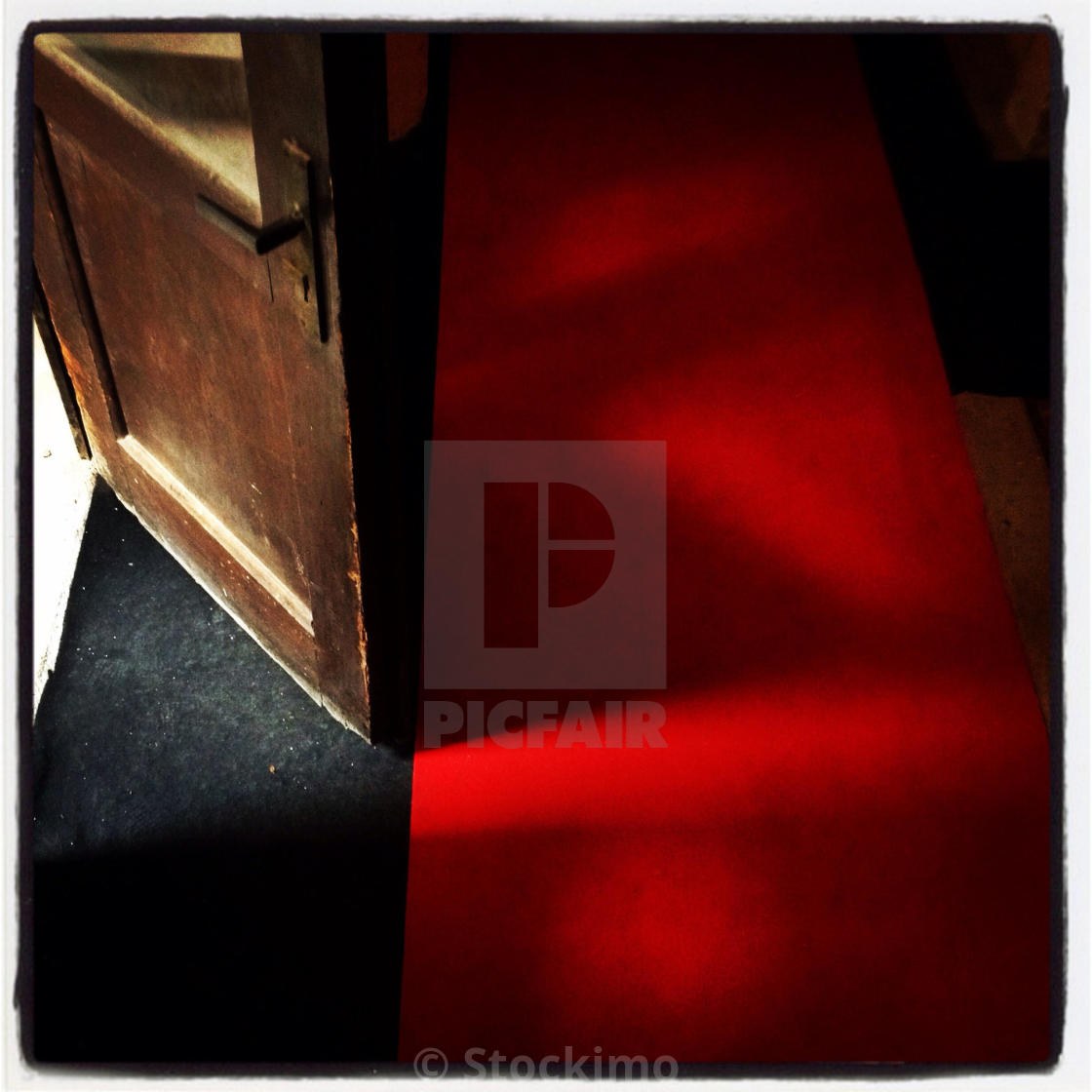 """Old red carpet and doors"" stock image"