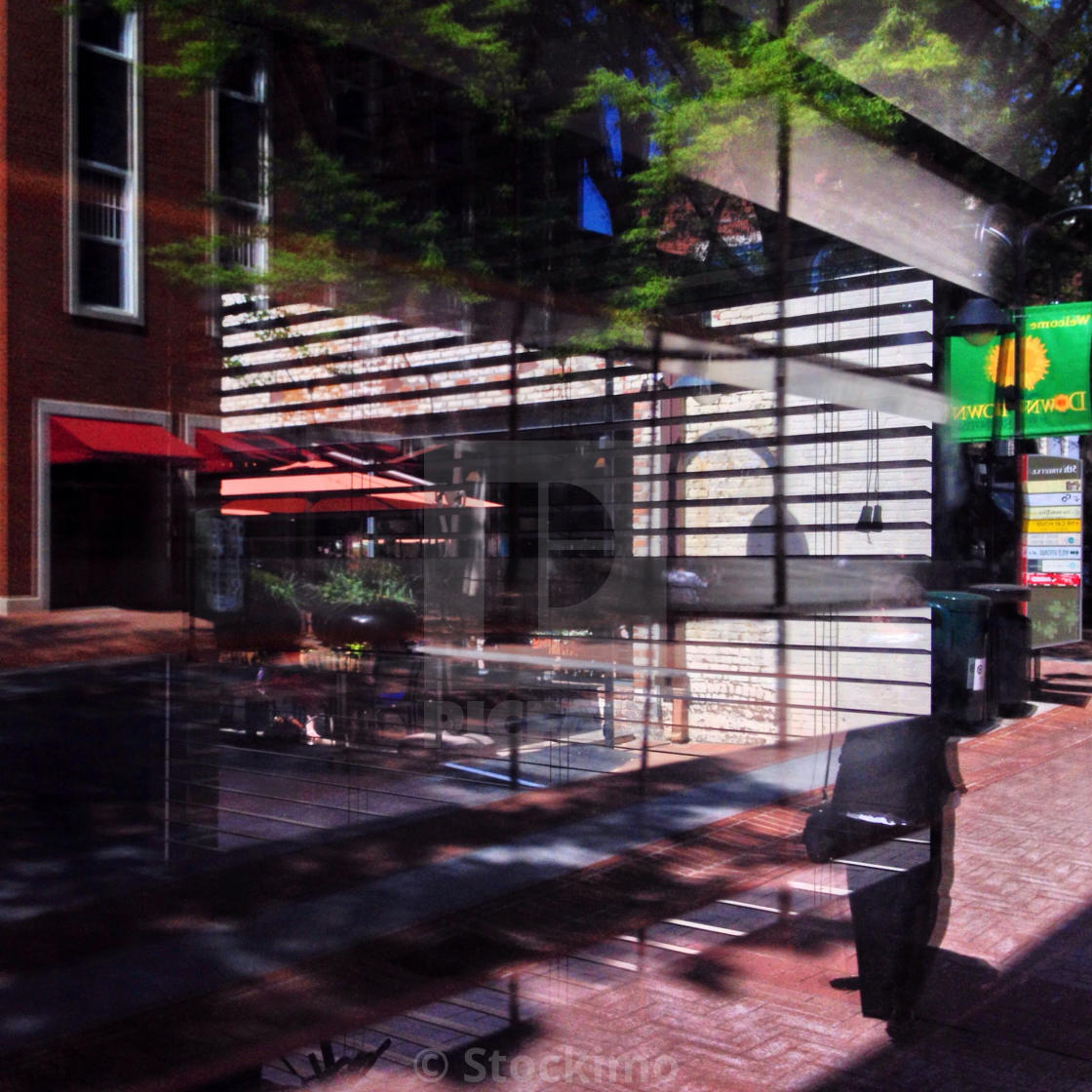 """Storefront reflections on The Mall in Charlottesville, VA"" stock image"