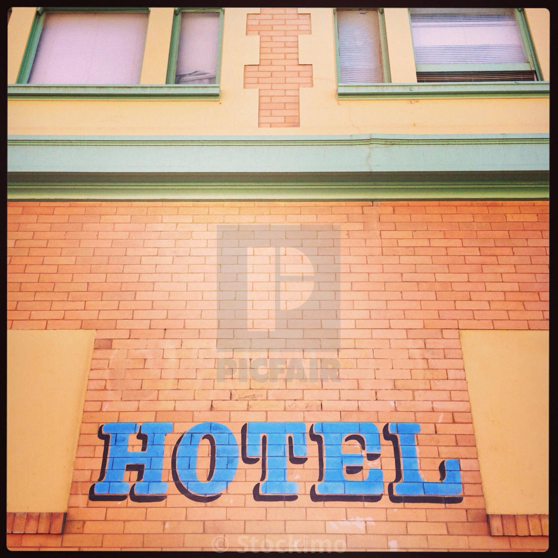 """Hotel sign on pink building"" stock image"