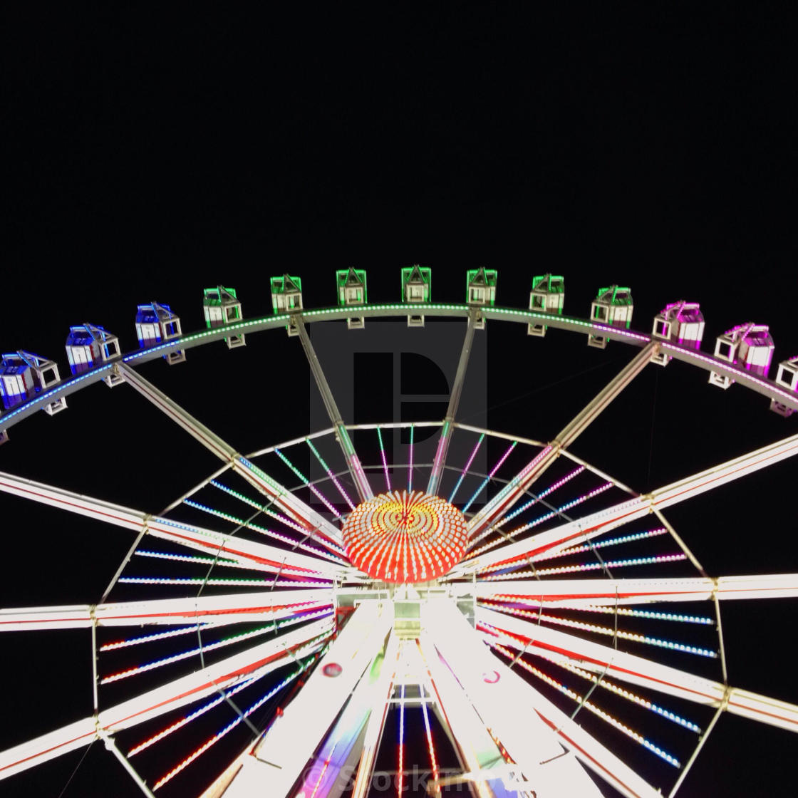"""Ferris wheel at night at Hamburger DOM fun fair, Hamburg, Germany"" stock image"