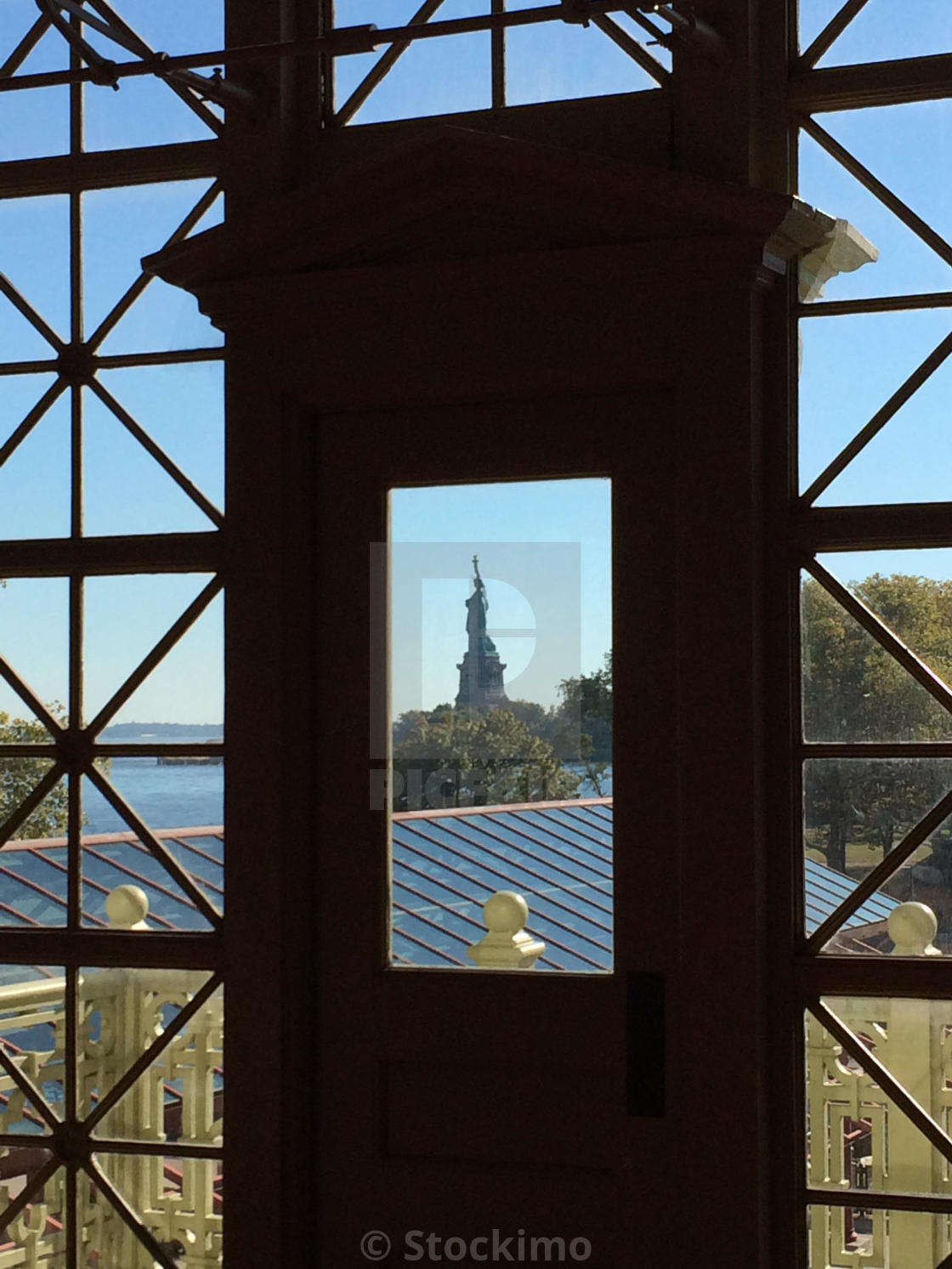 """""""The Statue of Liberty as seen from the Registration Room of the Ellis Island Immigration Museum in New York."""" stock image"""