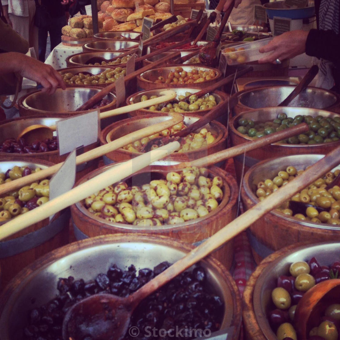 """""""Olives for sale on a market stall at Stroud farmers market, Gloucestershire, UK"""" stock image"""