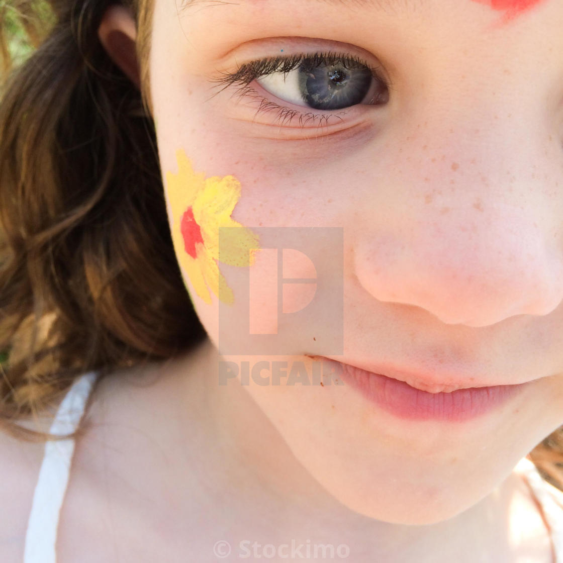 Close Up Of Five Year Old Girls Face With Face Painting License