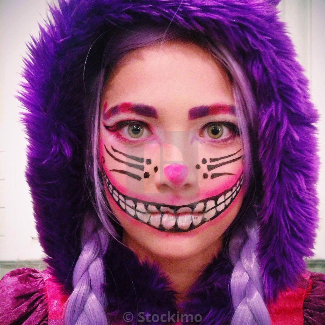 Girl In Cheshire Cat Costume For Halloween Party License Download