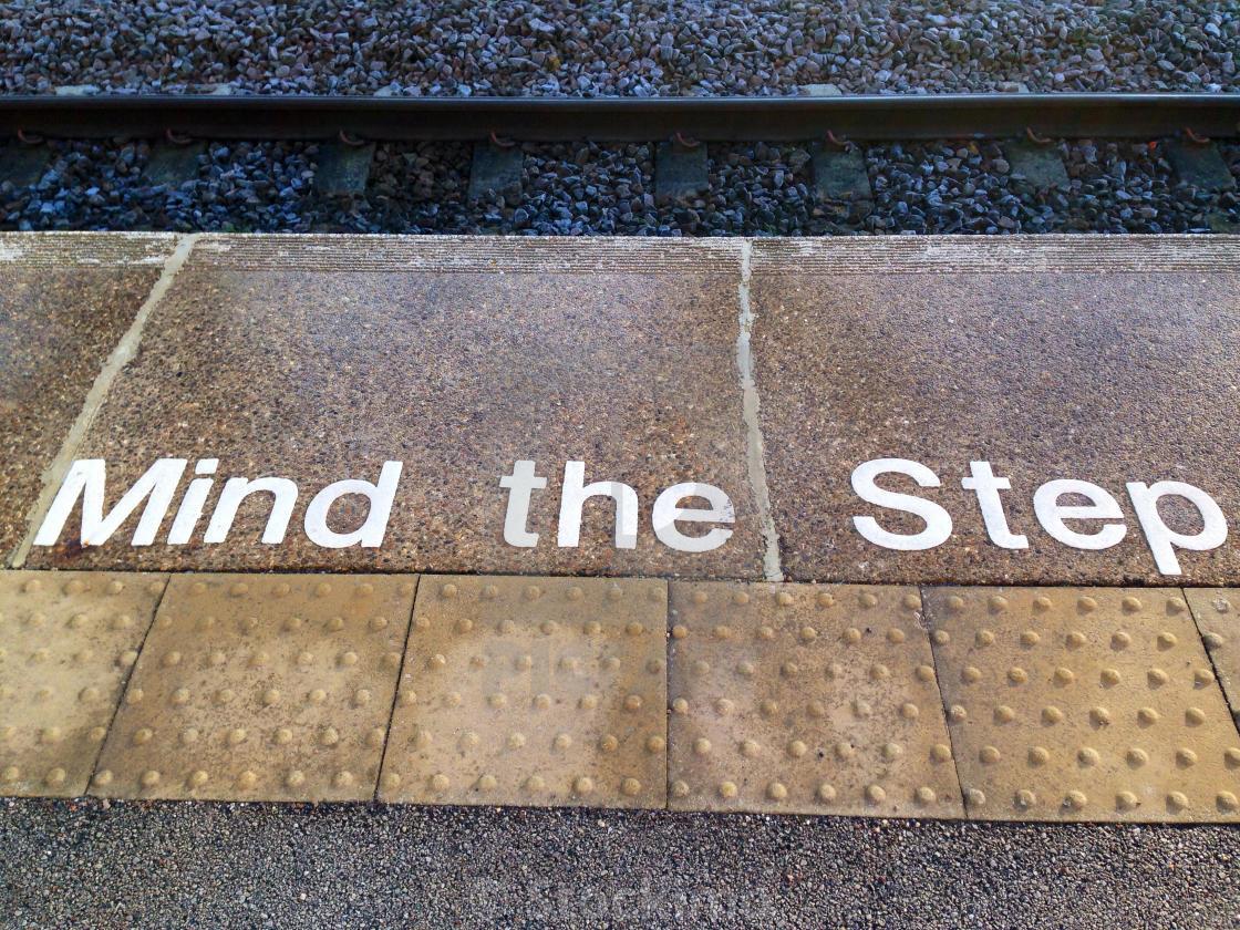 """Mind the step, UK railway platform edge"" stock image"