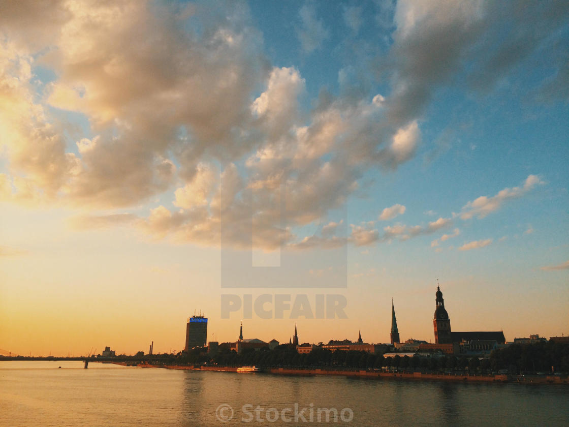 """Riga city skyline looking over Daugava river at sunset"" stock image"