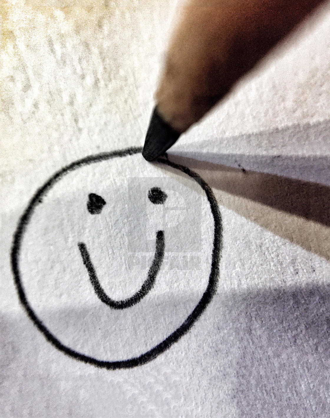 Pencil drawing of a happy smiling face stock image