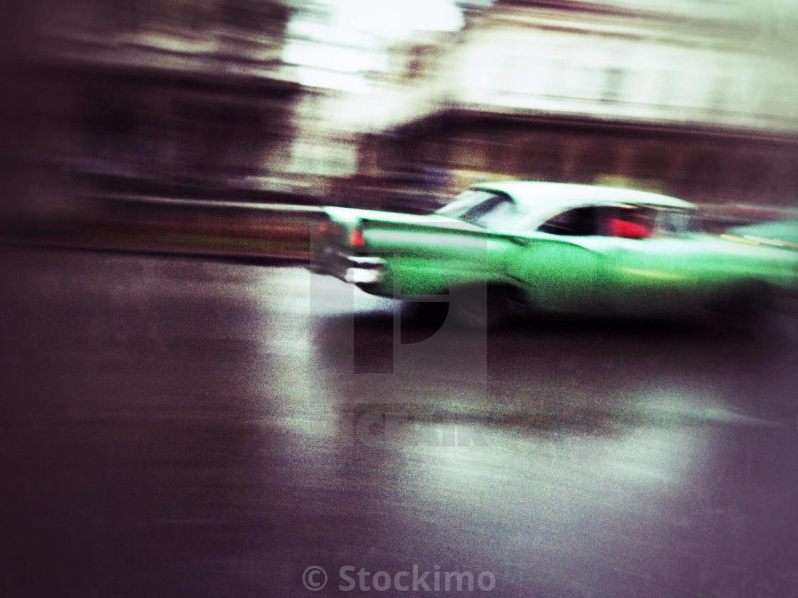 """Speeding green Cuban classic car, Havana"" stock image"