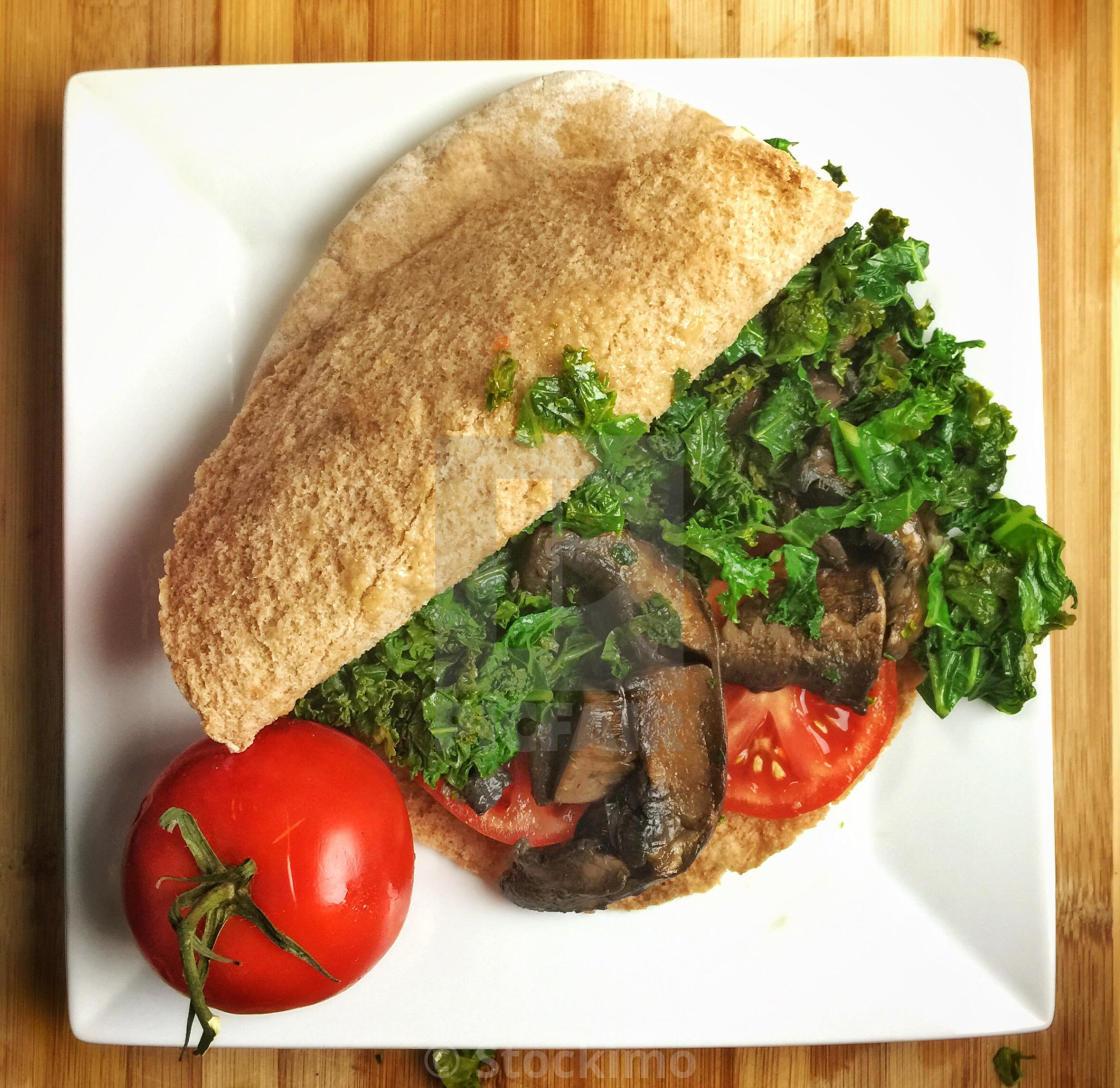 """Vegan pita sandwich with mushrooms and kale"" stock image"