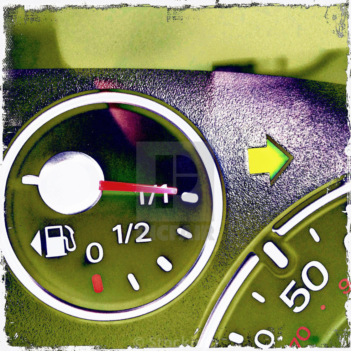 Car vehicle dashboard instruments speedometer showing fuel petrol
