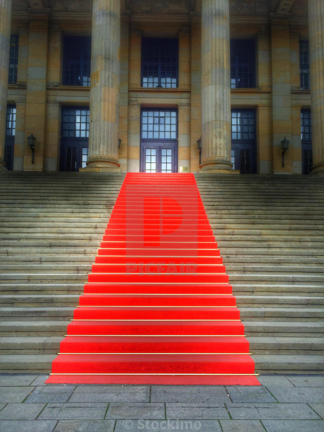 """Red carpet on the stairs"" stock image"