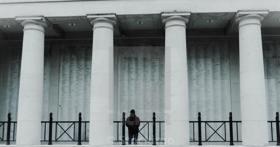 """""""Man looking at the names on the Menin Gate Ypres Belgium"""" stock image"""