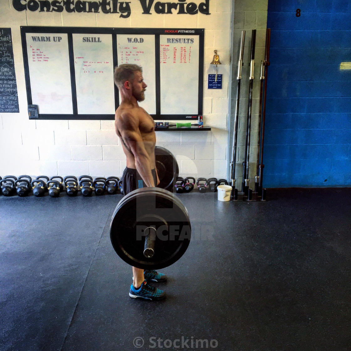 Male performs deadlift - License, download or print for