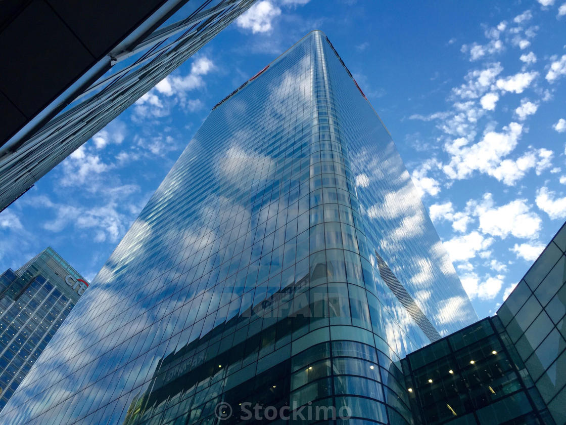 Reflection of clouds in windows of HSBC bank building at