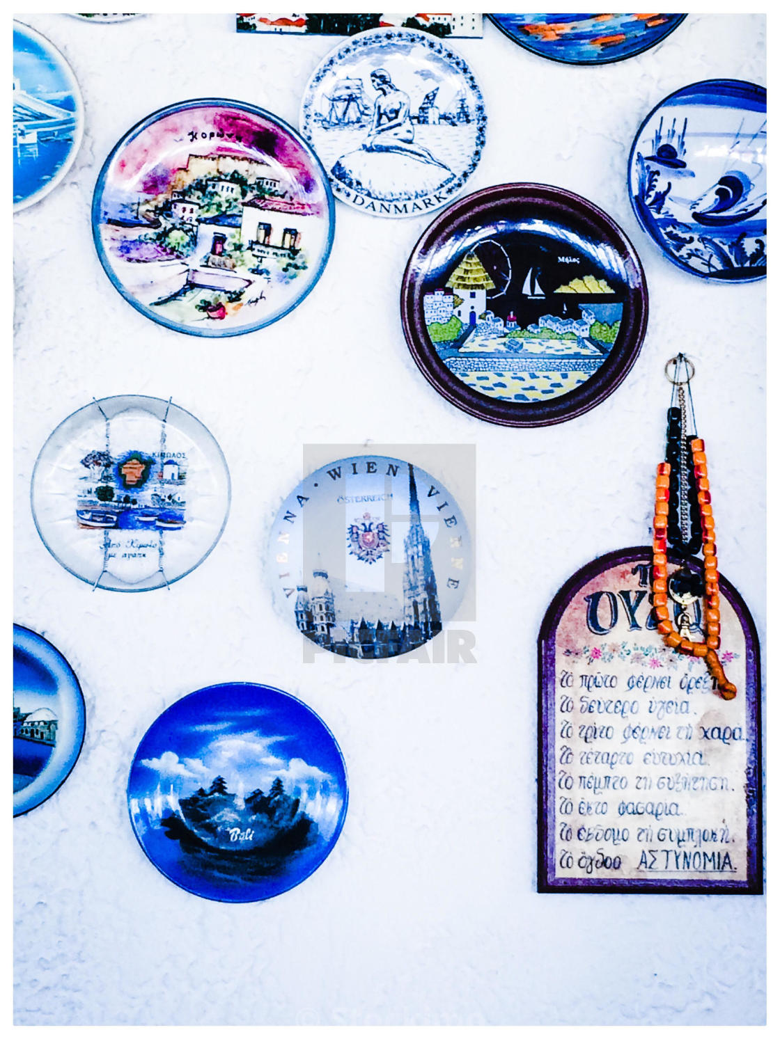 """Plates decorating wall of taverna Greece"" stock image"