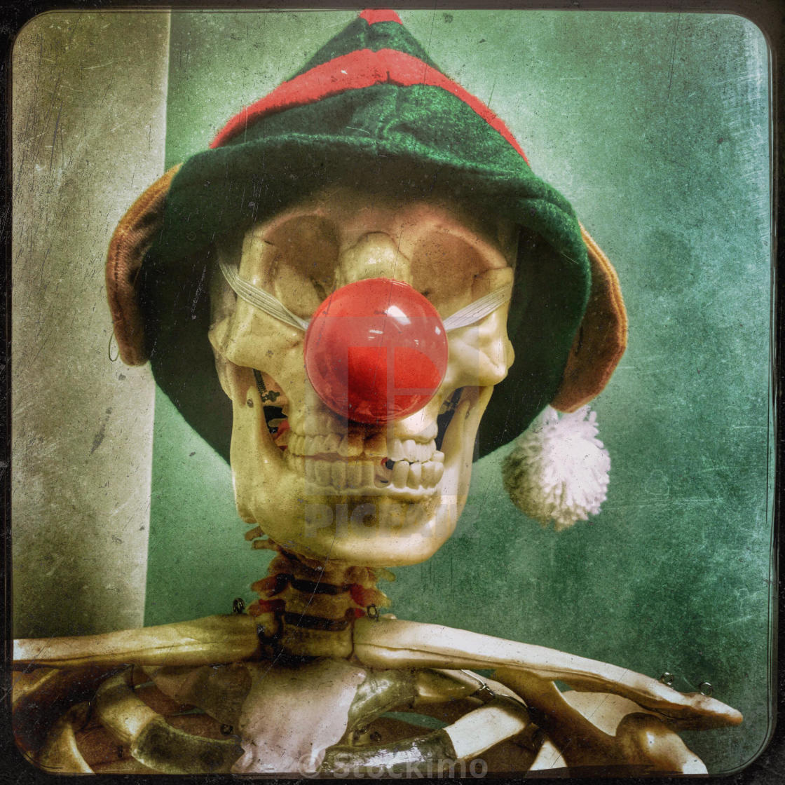 A scary skeleton posing as one of Santa's reindeer