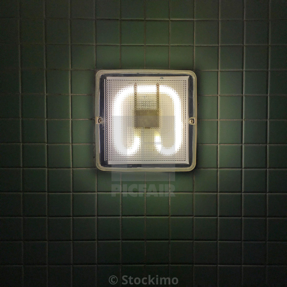 """Light in Bathroom against white tile. Influenced by William Eggleston"" stock image"