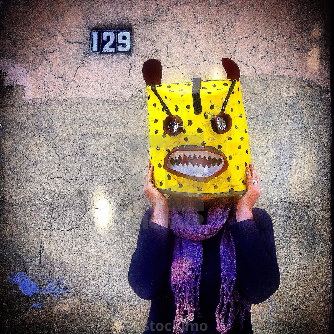 A woman wears a squared jaguar mask in Taller Tlamaxcalli toys and ...