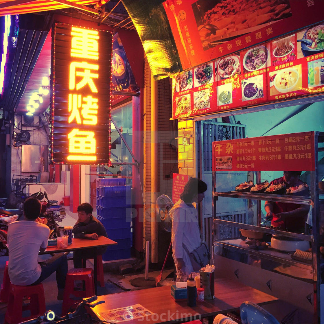 """Street restaurant in Guangzhou on a restaurant, China - Chongqing roasted fish."" stock image"