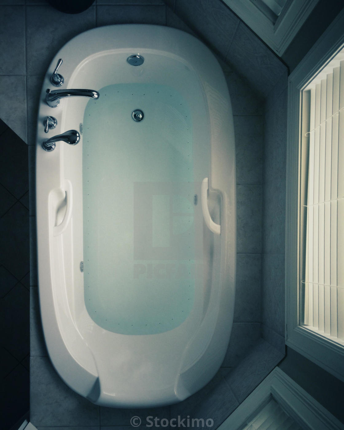 An overhead view of a bathtub with water. - License for £31.00 on ...