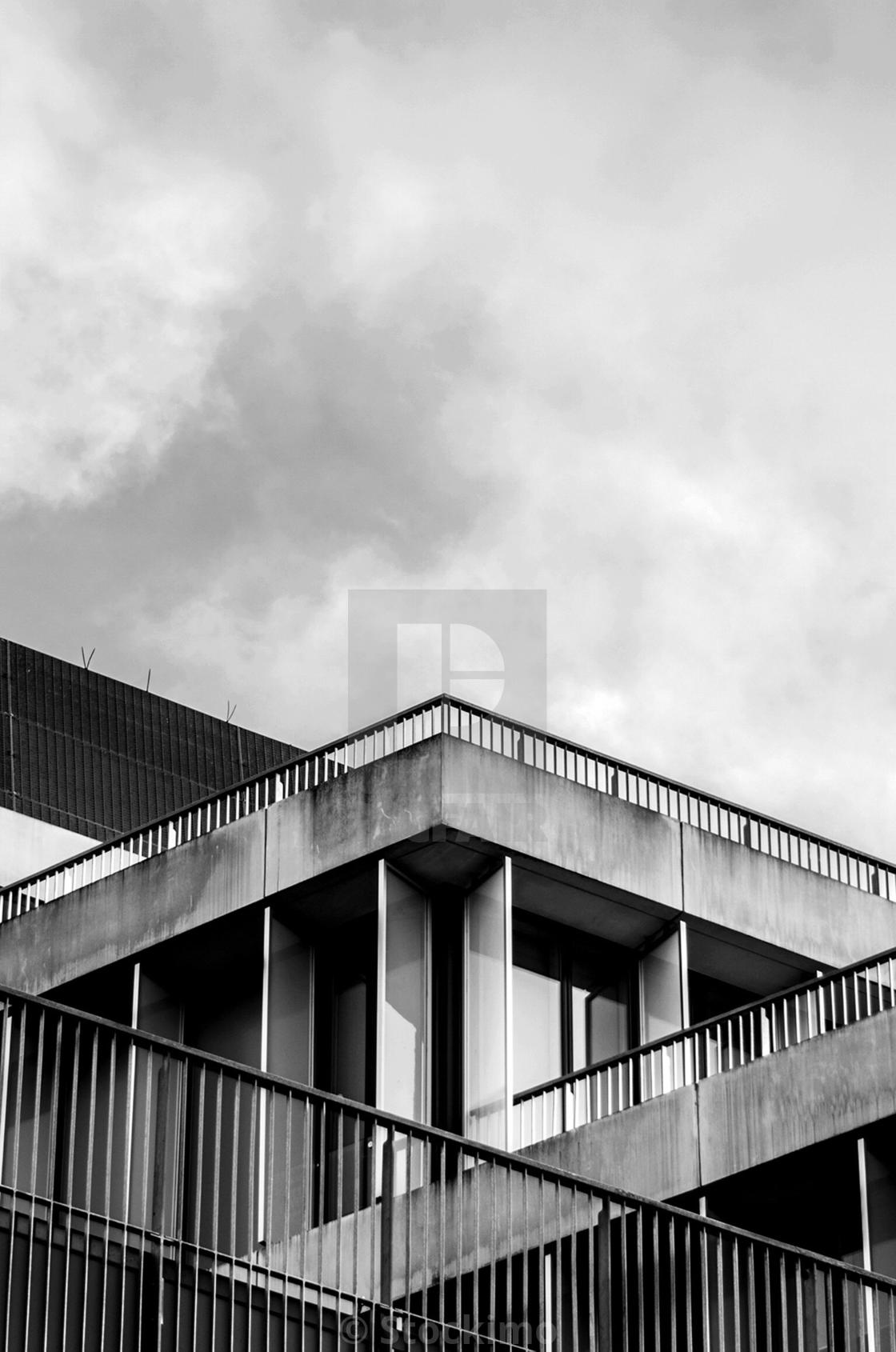 """Brutalist architecture railings with sharp angles shot in monochrome"" stock image"