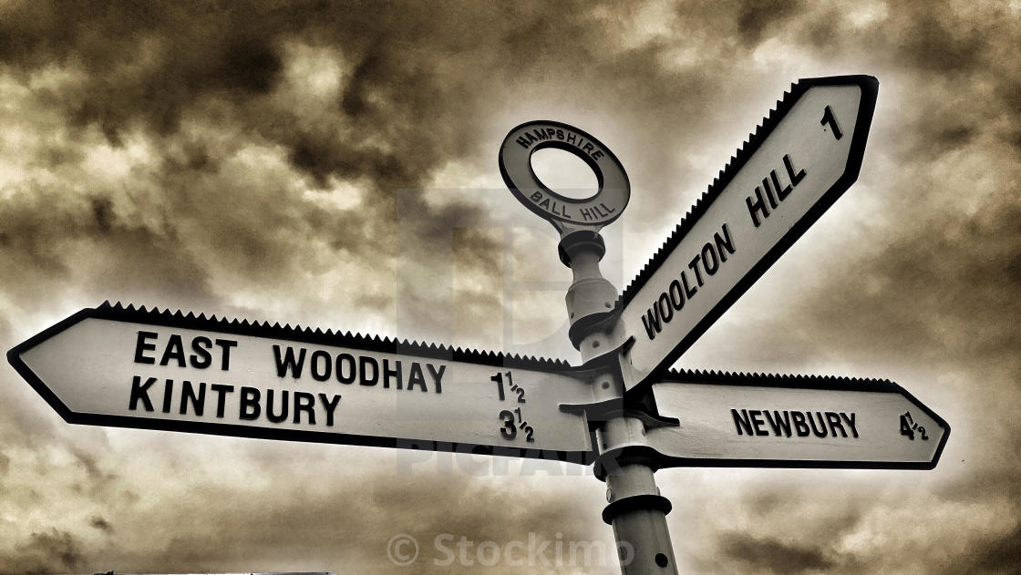 """""""Road sign with three directions to local villages and town, Newbury and surroundings"""" stock image"""