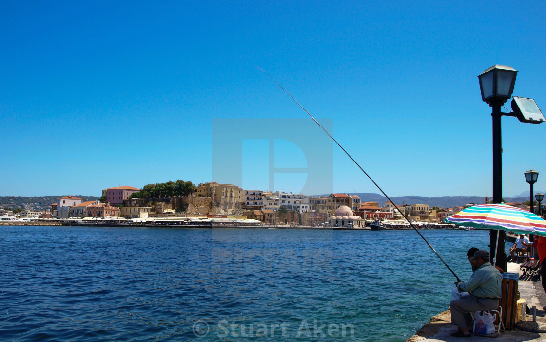 """Fishing in the harbour"" stock image"