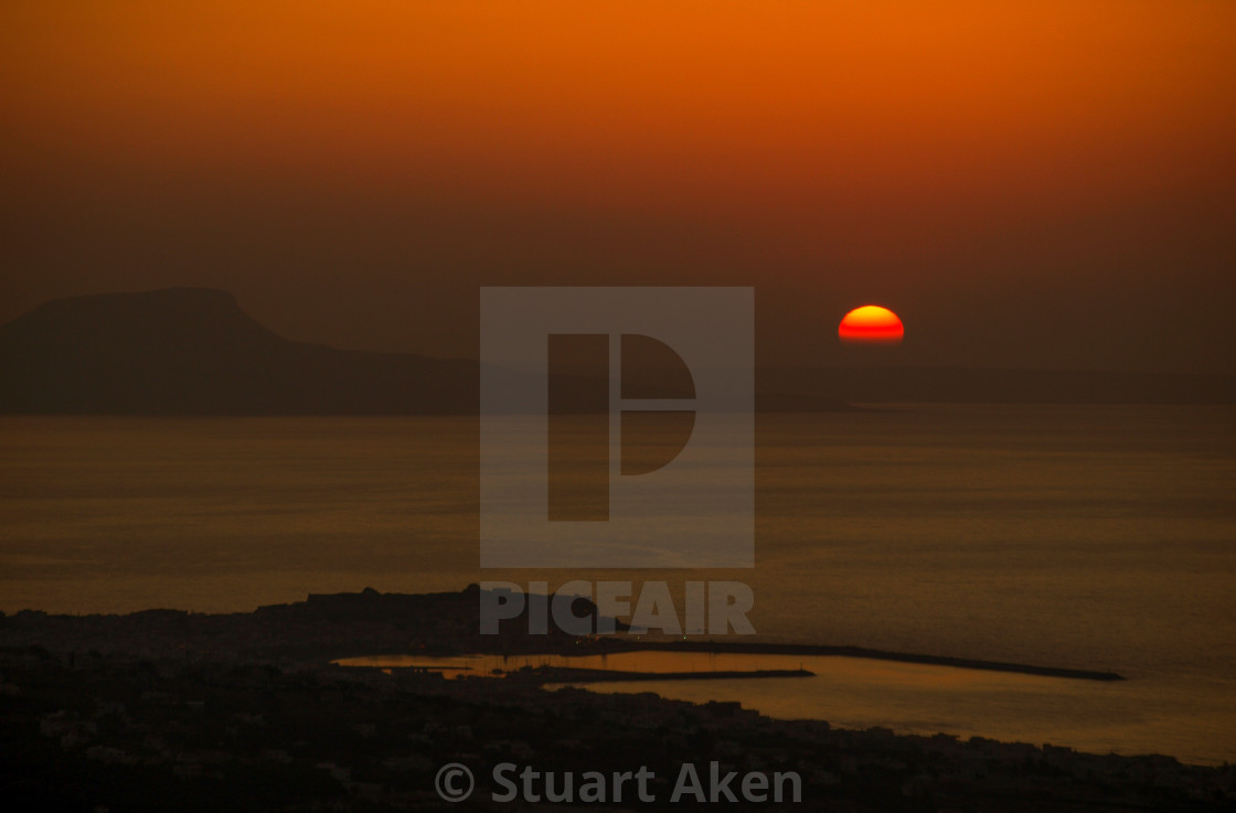 """Red Sun Sinking"" stock image"