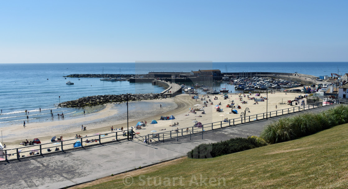 """At Lyme Regis Cobb and Beach"" stock image"