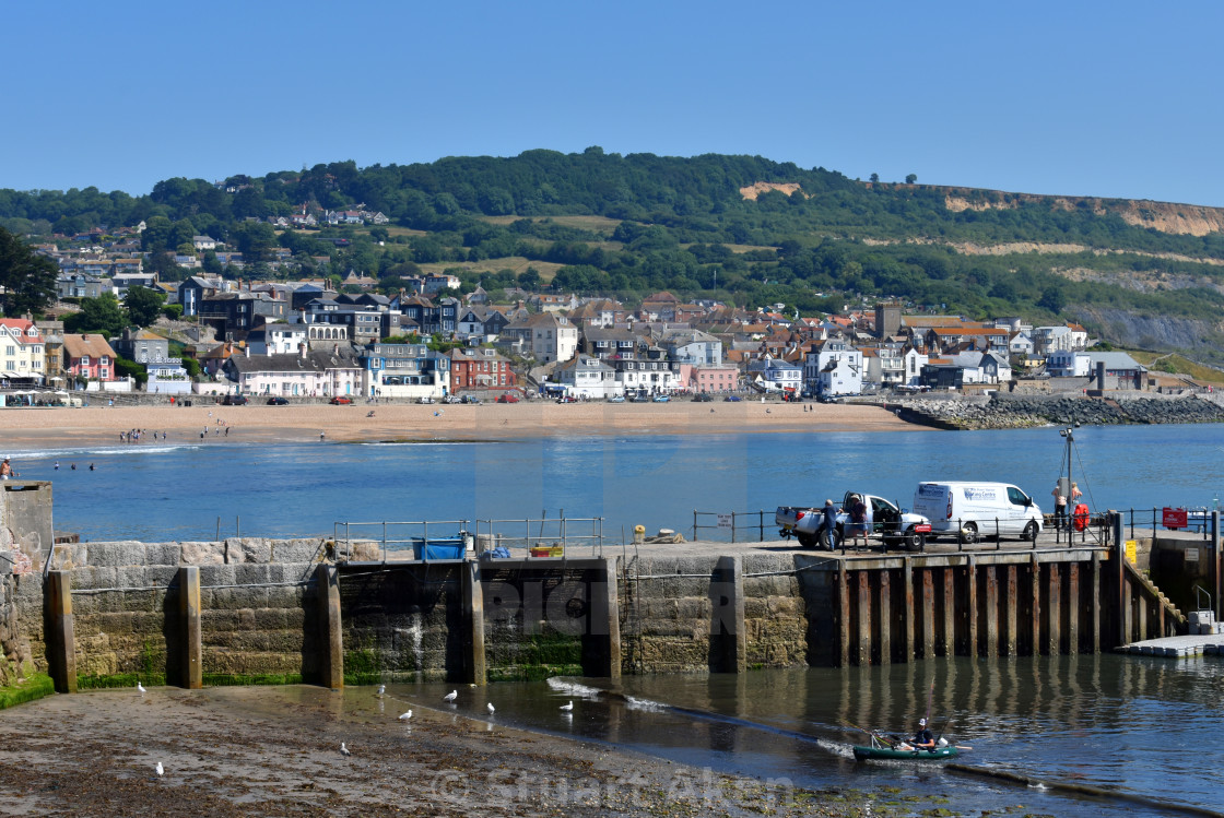 """Overlooking Lyme Regis from the Cobb"" stock image"