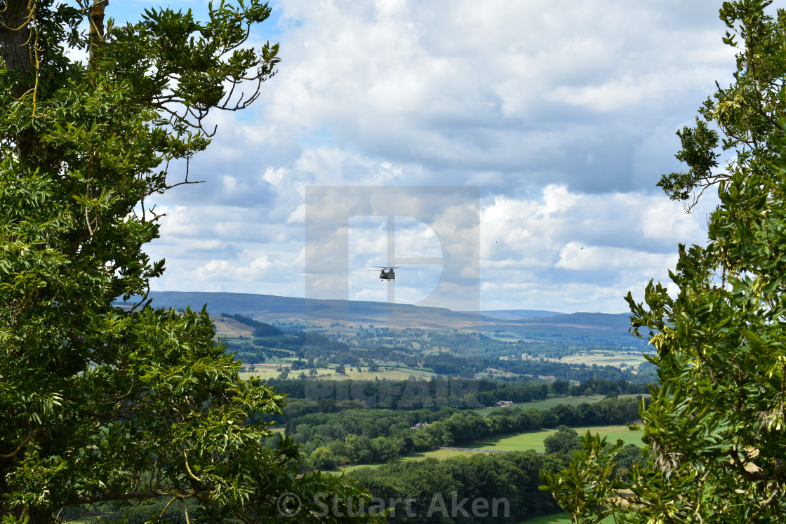 """""""Military Helicopter over Yorkshire Dales."""" stock image"""